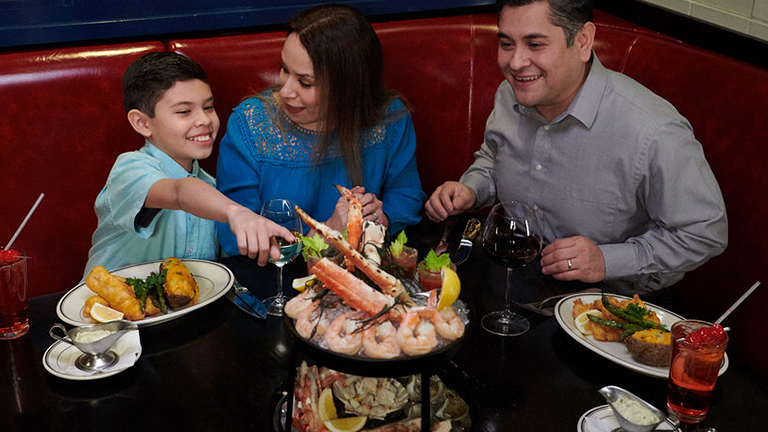 a family enjoying a feast at double cut